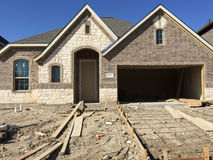 Nice new  house construction in suburban Royalty Free Stock Photography