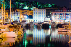 Nice Night, France. Image of yacht parked with a beautiful reflection of the city at night. In the background are seen the lights of the park in Nice, France Royalty Free Stock Photos