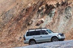 Nice Off-road vehicle at  Ak-Baital. AK-BAITAL, TAJIKISTAN - CIRCA JUNE 2017: Off-road vehicle at  Ak-Baital Pass in Tajikistan circa June 2017 in Ak-Baital Stock Images