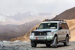 Nice Off-road vehicle at  Ak-Baital. AK-BAITAL, TAJIKISTAN - CIRCA JUNE 2017: Off-road vehicle at  Ak-Baital Pass in Tajikistan circa June 2017 in Ak-Baital Stock Photography