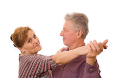 Nice old couple dancing on a white Stock Images