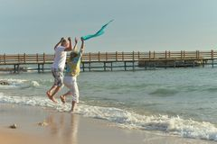 Nice old couple. Having fun on sea beach royalty free stock images