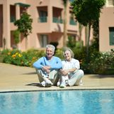 Nice old couple at pool Royalty Free Stock Photos