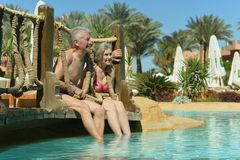 Nice old couple at pool stock photography