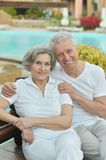 Nice old couple at pool Royalty Free Stock Photography