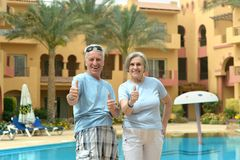 Nice old couple at pool Stock Image