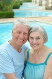 Nice old couple at pool Royalty Free Stock Photo