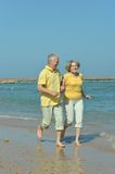 Nice old couple at resort Stock Images
