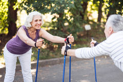 Nice old lady exercising opposite her husband Stock Image