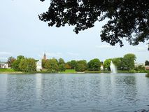 Beautiful white home and church near lake, Lithuania royalty free stock photos