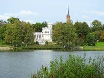 Beautiful white home and church near lake, Lithuania stock photos