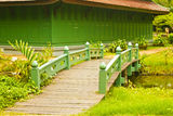 Nice old wooden bridge in park at summertime. Royalty Free Stock Images