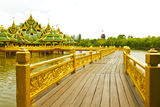 Nice old wooden bridge in park at summertime. Royalty Free Stock Photo
