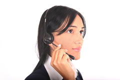 Nice operator I. Latin operator with headset attending the phone Stock Image