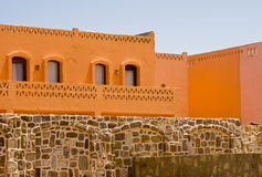 Nice orange hotel in Egypt with clear sky and wall Royalty Free Stock Image