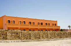 Nice orange hotel in Egypt with clear sky and wall Stock Image