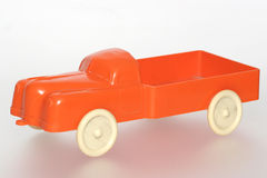 Nice orange plastic toy truck. Picture of a orange plastic toy truck from the 1960's or 70's. From my brothers toy collection Stock Image