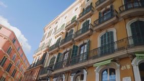 Nice orangle buildings with unusual windows in Palma. On sunny autimn day stock footage