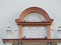 Beautiful catholic church frame with ornaments, Lithuania. Nice ornaments - sun and flowers on Catholic church in Kretinga town royalty free stock photos