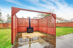 Nice outdoor fireplace with fence. Royalty Free Stock Photos