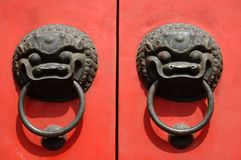 Nice Pair of Knockers. Lion door knockers, on a red door in China royalty free stock photos
