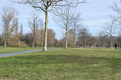 Nice park. Green park with poeple walking round in the nice weather Royalty Free Stock Photo
