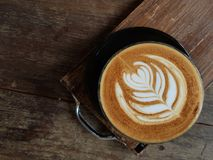 Nice pattern of hot coffee latte art. The heart shape leaf is the famous shape for hot coffee royalty free stock photos