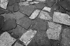 Nice patterned stone pavement in Prague ideal for background image in black and white stock image