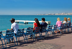Nice - People sit on chairs Royalty Free Stock Photography