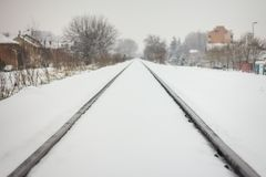 Nice perspective view of railway in snow. Winter landscape with royalty free stock photo