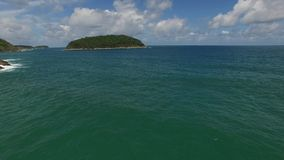 Nice Phuket coast & green trees, from a helicopter. Attractive coast, ocean waves, from a drone stock footage