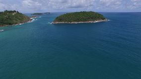 Nice Phuket coast & green trees, from a helicopter. Attractive coast, ocean waves, from a drone stock video