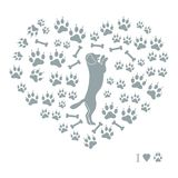 Nice picture of dog standing on its hind legs silhouette on a ba. Ckground of dog tracks and bones in the form of heart on a white background Royalty Free Stock Photo