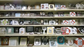 Nice picture frames  on shelves selling Stock Image