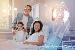 Nice picture of a friendly family smiling in a modern hospital stock photos