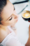 Nice picture of resting brunette woman holding a cup of coffee Royalty Free Stock Photography