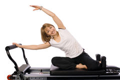A nice pilates girl. The girl is doing pilates on the allegro Royalty Free Stock Images