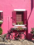 Pretty bike near the pink house on Burano island stock image