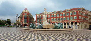 Nice - Place Massena and Apollo. NICE, FRANCE - APRIL 27: View to Place Massena and fountain Soleil on April 27, 2013 in Nice, France. The square was stock photography