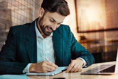 Cheerful businessman creating his daily agenda Royalty Free Stock Photography