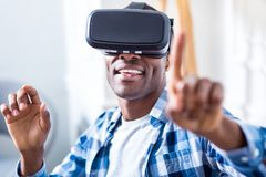 Nice pleasant man using modern technology Stock Photo
