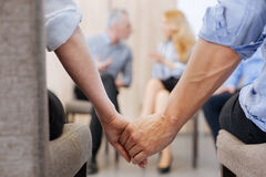 Nice pleasant people holding their hands Royalty Free Stock Photo