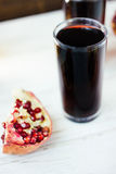 Nice pomegranate drink - fresh juice on white wooden surface. Stock Photography