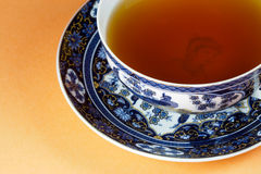 Lets have a cup of tea!. Nice porcelain tea cup with delicious tea Royalty Free Stock Images