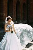 Nice portrait of the amazing bride with the bouquet Royalty Free Stock Photos
