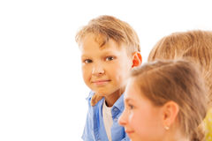 Nice portrait of boy among kids with modest smile Stock Photo