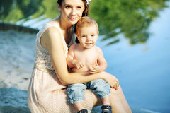 Nice portrait of the mother hugging her baby Stock Photography