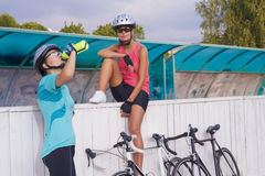 Nice portrait of two girlfriends having a water break together.h Royalty Free Stock Photos