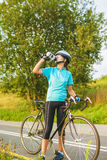Nice Portrait of young female cyclist athlete having a break. Stock Photo