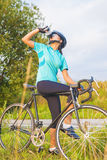 Nice Portrait of young female cyclist athlete having a water bre Royalty Free Stock Photo